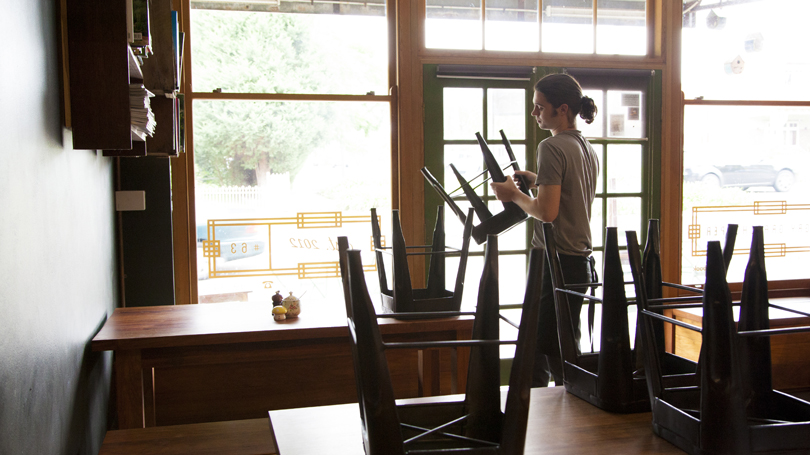 man-stacking-cafe-chairs_810x455.jpg