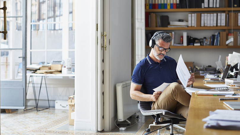man-at-desk-with-headphones_810x455.jpg